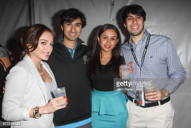 Guests attend the Carolina Herrera Fashion Show with GREY GOOSE Vodka at the Cadillac Championship at Trump National Doral on March 7 2014 in Doral...