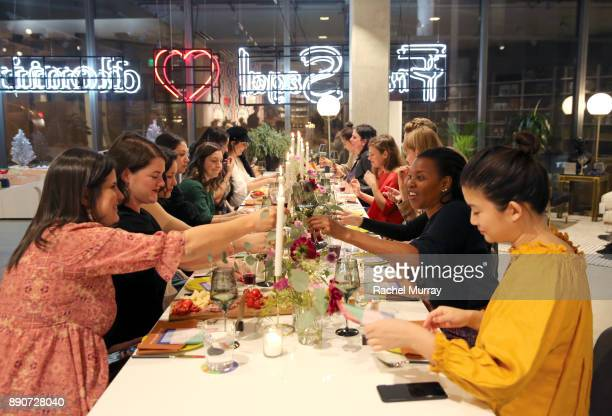 Guests attend the Domino Outpost CB2 Influencer Dinner at Fred Segal on December 11 2017 in Los Angeles California