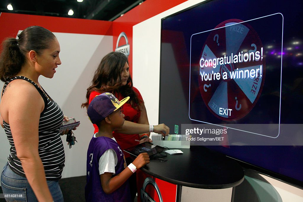 Guests attend the Fan Fest Nissan 'Surprise Inside' Booth