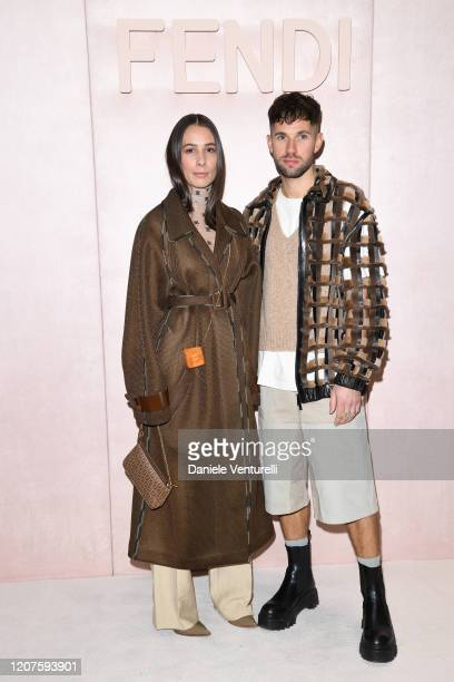 Guests attend the Fendi fashion show on February 20, 2020 in Milan, Italy.