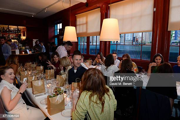 Guests attend the Finery 'Fine Dining' Private dinner at The Richmond on April 28 2015 in London England