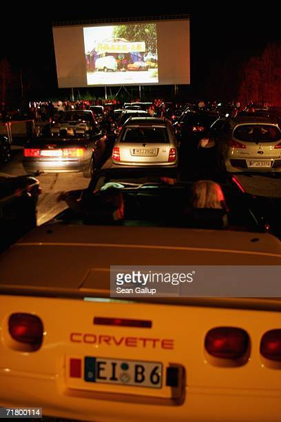 Guests attend the German premiere of the animated film 'Cars' at a drivein movie theatre on September 6 2006 in Munich Germany