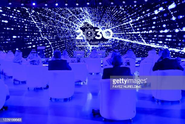 Guests attend the Global AI 2020 Summit in the Saudi capital Riyadh on October 21, 2020. - The summit, organised by the Saudi Data & AI Authority and...