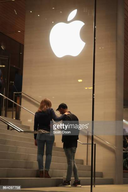 Guests attend the grand opening of Apple's Chicago flagship store along Michigan Avenue on October 20 2017 in Chicago Illinois The glasssided store...