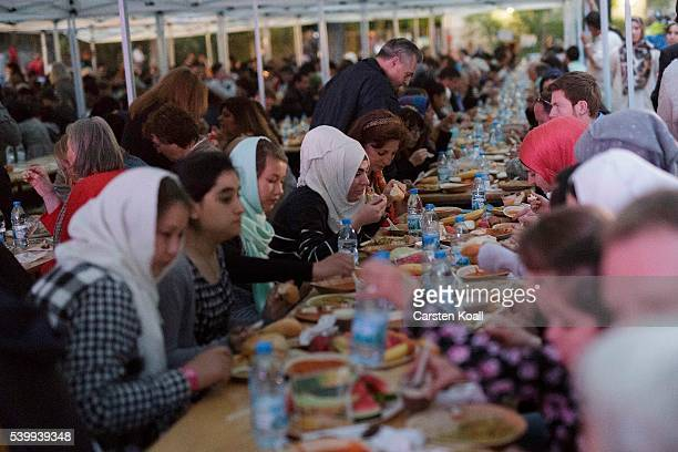 Guests attend the Iftar meal of the Muslims at the end of Ramadan on 13 June 2016 to observe Berlin Germany Iftar is daily sunset meal when Muslims...