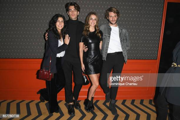 Guests attend the Miu Miu aftershow party as part of the Paris Fashion Week Womenswear Spring/Summer 2018 at Boum Boum on October 3 2017 in Paris...