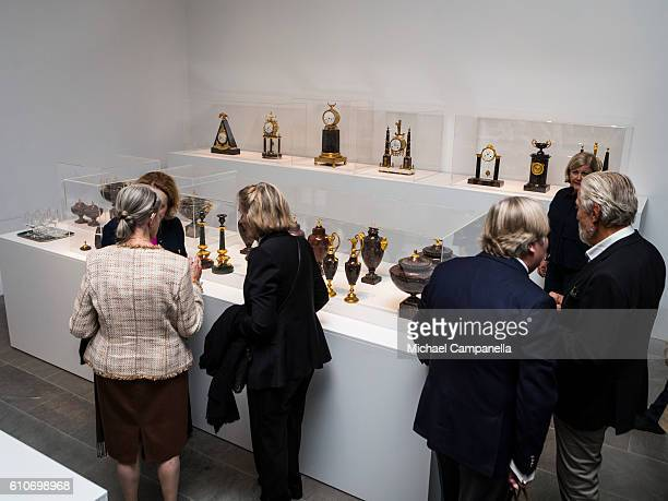 Guests attend the opening of the 'Porphyry The Royal Stone' exhibition at SvenHarrys art museum on September 27 2016 in Stockholm Sweden