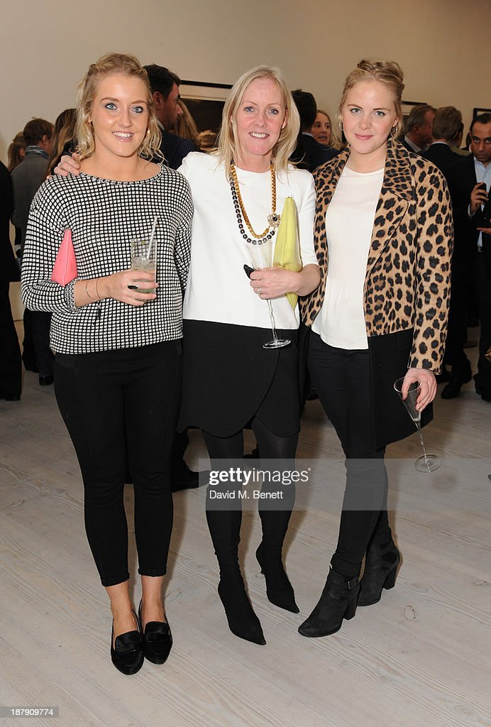 Guests attend the private view of ENCOUNTER the stunning wildlife photography of David Yarrow at Saatchi Gallery on November 13, 2013 in London, England.
