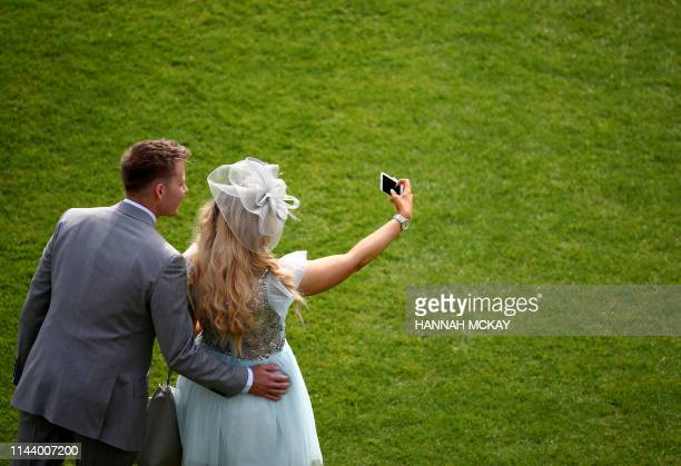 Guests attend the Queen's Garden Party at Buckingham Palace in central London on May 15 2019