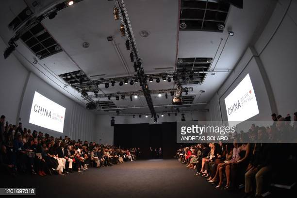 """Guests attend the show of Chinese designer Han Wen's Fall - Winter 2020 collection, as part of the """"China, We are With You"""" fashion event, kicking..."""