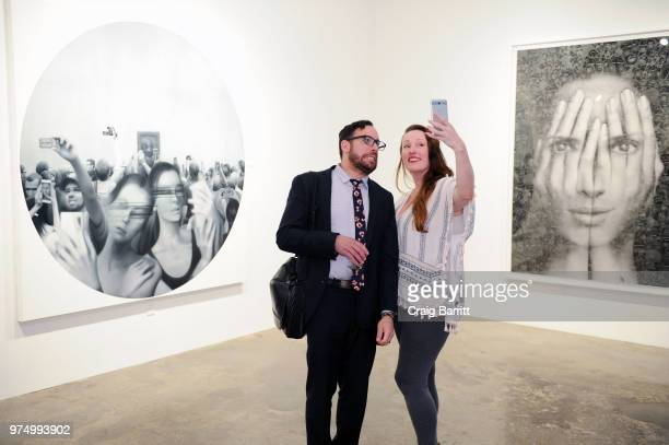 Guests attend the Tigran Tsitoghdzyan 'Uncanny' show at Allouche Gallery on June 14 2018 in New York City