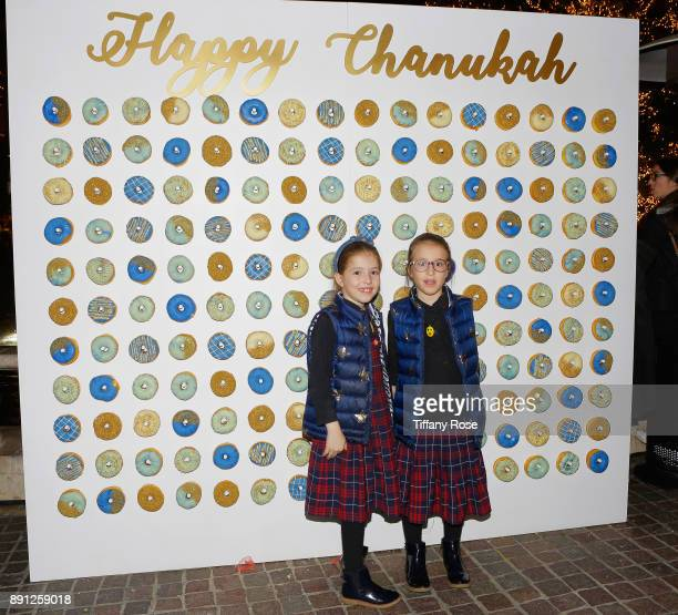 Guests attend the Village Synagogue and Emmanuelle Chriqui Host Menorah Lighting Ceremony at The Grove on December 12 2017 in Los Angeles California