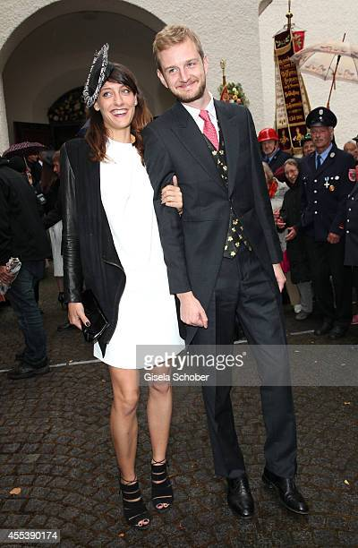 Guests attend the wedding of Maria Theresia Princess von Thurn und Taxis and Hugo Wilson at St Joseph Church in Tutzing on September 13 2014 in...