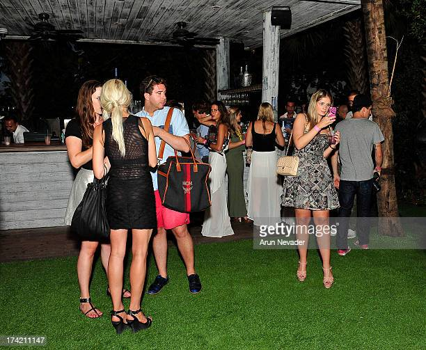 Guests attend the Wildfox Swim Cruise 2014 VIP BBQ at Soho Beach House on July 21 2013 in Miami Beach Florida
