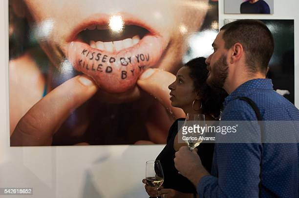 Guests attend the Year In Focus by Getty Images exhibition at the Spainmedia Gallery on June 23, 2016 in Madrid, Spain.