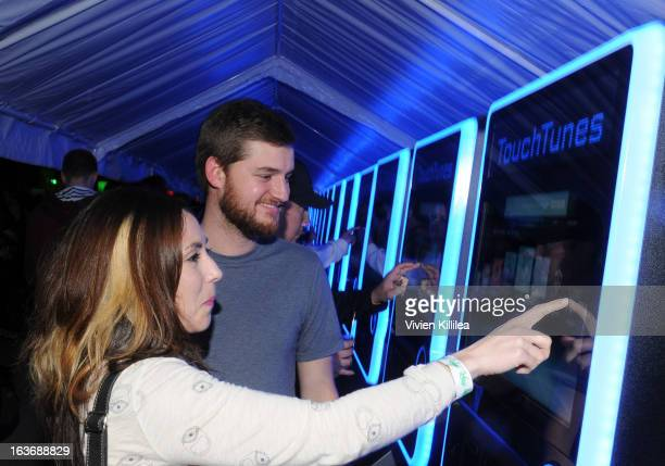 Guests attend TouchTunes Enabled Crowdsourced Music At The 2013 frog SXSW Interactive Opening Party at Palmer Events Center on March 8 2013 in Austin...