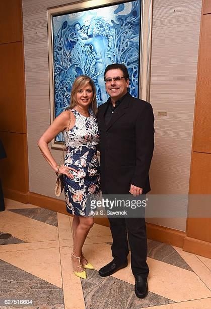 Guests attend Underwater Dreams To Life In Color Art Exhibit Featuring Antonio Dominguez De Haro And Romero Britto At Four Seasons Hotel Miami at The...