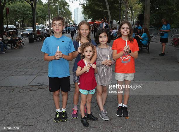 Guests attend US Fund for UNICEF as it calls on world leaders to put children first during a candlelight vigil at Dag Hammarskjold Plaza on September...