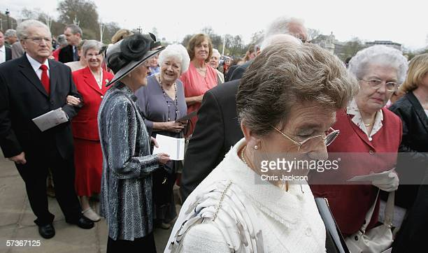 Guests attending the Queen's 80th Birthday Lunch wait for their identification to be checked on April 19, 2006 at Buckingham Palace in London,...