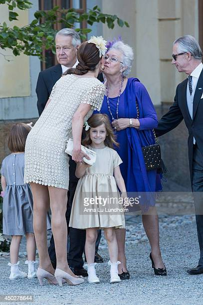 Guests attending the Royal Christening for Princess Leonore at Drottningholm Palace Chapel enter caption here on June 8 2014 in Stockholm Sweden