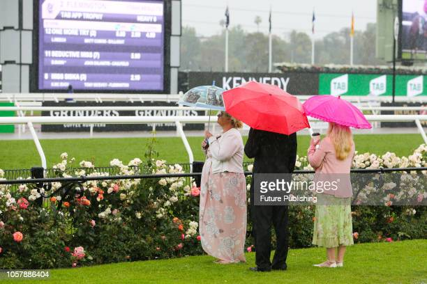 Guests braving the rain on Lexus Melbourne Cup Day at the 2018 Melbourne Cup Carnival