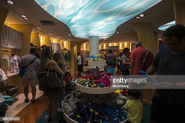 Guests browse souvenirs inside the gift shop at AquaRio South America's largest aquarium in Rio de Janeiro Brazil on Saturday Dec 3 2016 AquaRio...