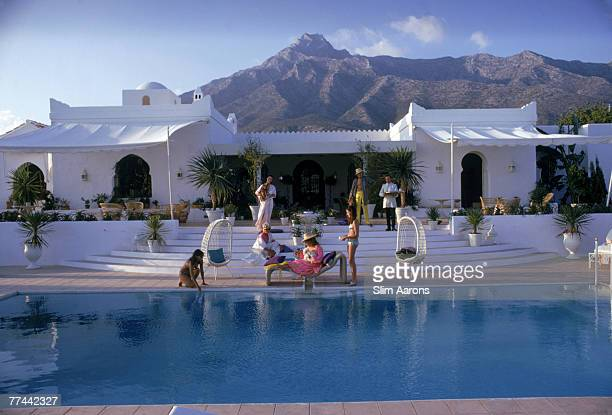Guests by the pool at 'El Venerol' the villa of Hector and Chico de Ayala Marbella Spain August 1967