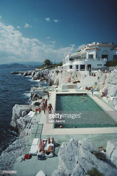 Guests by the pool at the Hotel du Cap Eden-Roc, Antibes, France, August 1976.