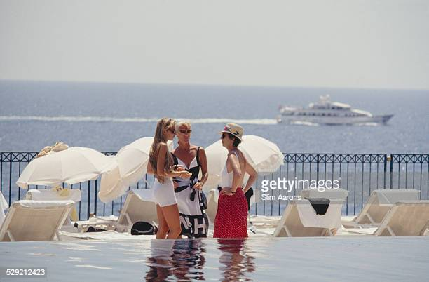 Guests by the swimming pool on a terrace at the Hotel BelAir on Cap Ferrat on the Côte d'Azur southeastern France July 1991