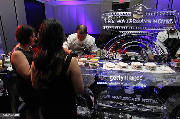 Guests celebrate at the grand reopening party of the iconic Watergate Hotel on June 14 2016 in Washington DC