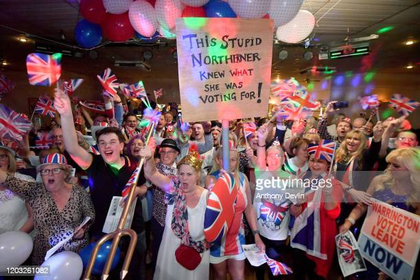 Guests celebrate the moment the UK leaves the EU during the Brexit party at Woolston Social Club on January 31, 2020 in Warrington, United Kingdom....