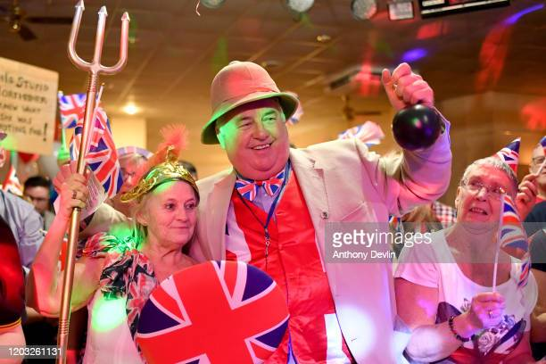 Guests celebrate the moment the UK leaves the EU during the Brexit party at Woolston Social Club on January 31 2020 in Warrington United Kingdom At...