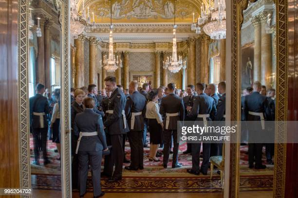 Guests chat during a reception to mark the centenary of the Royal Air Force at Buckingham Palace in central London on July 10 2018