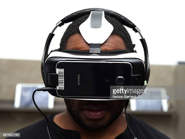 Guests check out 360degree THE HUNGER GAMES VIRTUAL REALITY Experience using the Samsung Gear VR at STAND WITH THE MOCKINGJAY Powered by Samsung...