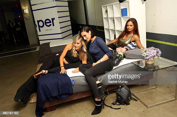 Guests check out the Casper mattresses during Casper's LA celebration at Blind Dragon on July 9 2015 in West Hollywood California