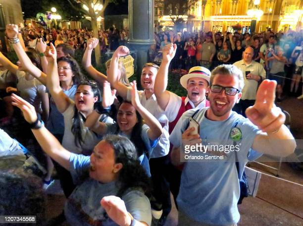 Guests cheer as Mickey Mouse and friends make a surprise appearance on Main Street USA in the Magic Kingdom at Walt Disney World in the final minutes...