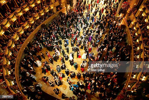 Guests dance a waltz at the Vienna Opera Ball at the city's opera house February 19 2004 in Vienna Austria