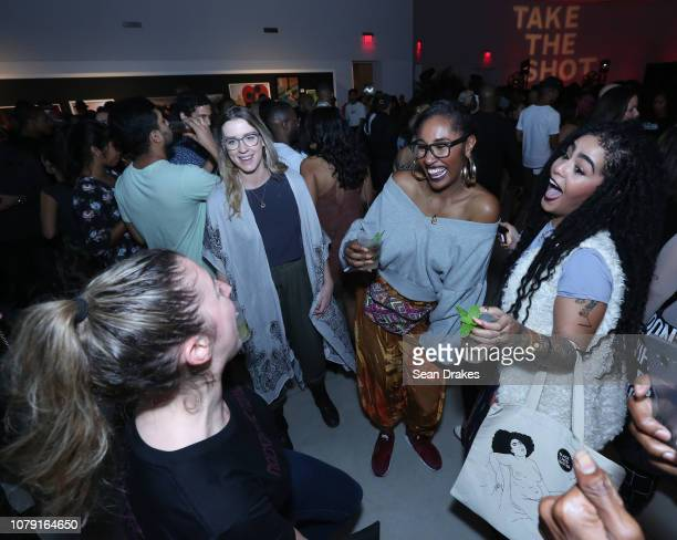 Guests dance at the Bacardi No Commission Marquee Performance hosted by Swizz Beatz and The Dean Collection at Faena Forum as part of the 2018 Art...