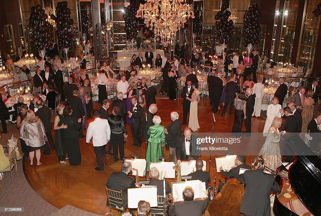 Guests dance at the surprise 80th birthday party for legendary musician Bobby Short, September 12, 2004 at the Rainbow Room in New York City.