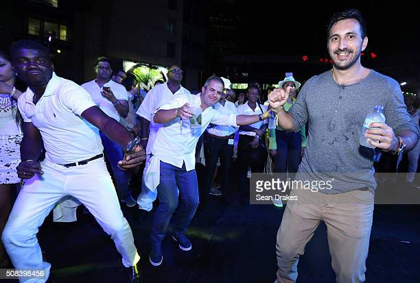 Guests dance during a performance by Chris 'The Jillionaire' Leacock at the Hyatt LIME fete at Hyatt Regency Trinidad as part of Trinidad and Tobago...