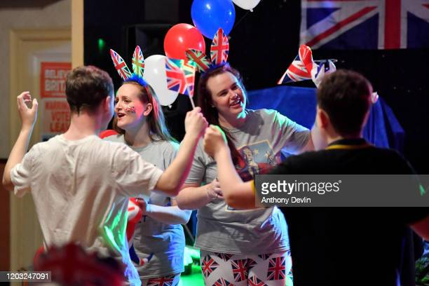 Guests dance during the Brexit party at Woolston Social Club on January 31, 2020 in Warrington, United Kingdom. At 11.00pm on Friday 31st January the...