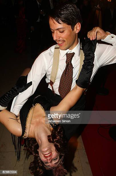 Guests dance during the 'Fabulous Celebration' at Nymphenburg Castle on September 18 2008 in Munich Germany French champagne producer Moet Chandon...