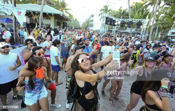 Guests dance to DJ music during the Chuckie Friends Party hosted by 935FM Revolution Radio Miamias part of Miami Music Week at the National Hotel on...
