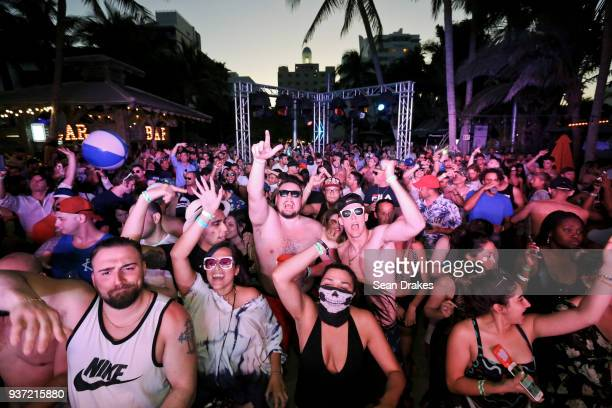 Guests dance to DJ music during the Chuckie Friends Party hosted by 935FM Revolution Radio Miami as part of Miami Music Week at the National Hotel on...