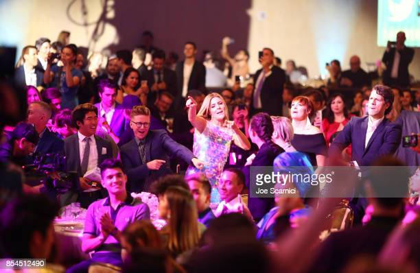 Guests dance while Village People perform at the 2017 Streamy Awards at The Beverly Hilton Hotel on September 26 2017 in Beverly Hills California