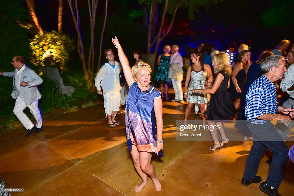 Guests dancing at LongHouse Reserve 2016 Jubilee Year Summer Benefit, Serious Moonlight at LongHouse Reserve on July 23, 2016 in East Hampton, NY.