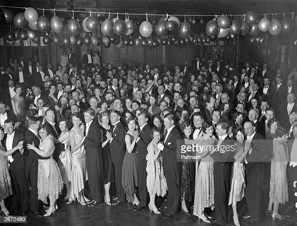 Guests dancing in the ballroom aboard Cunard liner 'Berengaria' at Southampton Docks. They are attending a dance and cabaret to raise funds for...