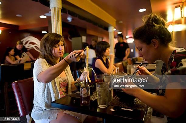 Guests Danielle Decatur and Lauren Donovan enjoy their bowls of Ramen at Sakuramen Ramen Bar on Tuesday July 5th 2012