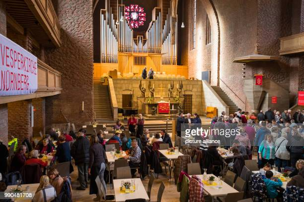 Guests dine at the evangelical Gustav Adolf Memorial Church in Nuremberg Germany 14 January 2018 For a symbolic contribution of 1 Euro the Christian...