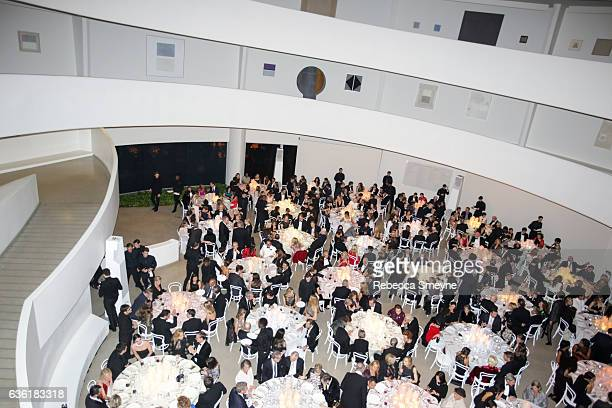 Guests dine in the rotunda at the Guggenheim International Gala at the Solomon R Guggenheim Museum on November 17 2016 in New York City